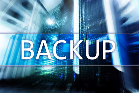 Backup button on modern server room background. Data loss prevention. System recovery. Server room