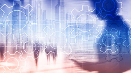 Double exposure gears mechanism on blurred background. Business and industrial process automation concept. 写真素材
