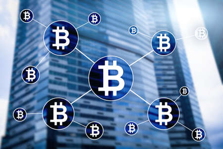 Bitcoin cryptocurrency and blockchain technology concept on blurred skyscrapers background Stok Fotoğraf