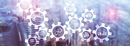 Tecnologia di automazione e concetto di industria intelligente su sfondo sfocato astratto. Ingranaggi e icone.