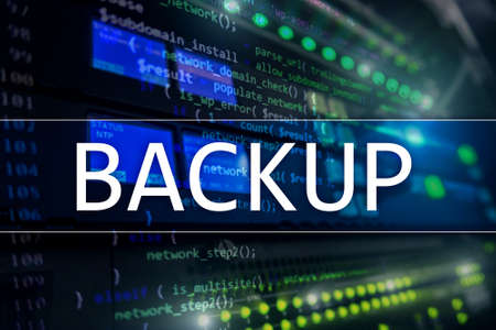Backup button on modern server room background. Data loss prevention. System recovery.