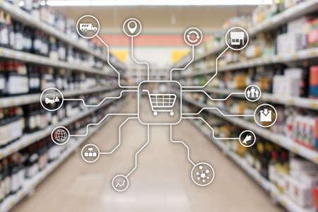 Canales de marketing minorista Concepto de automatización de compras de comercio electrónico sobre fondo de supermercado borroso Foto de archivo