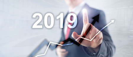 New year 2019 Financial growth graph on blurry business background.