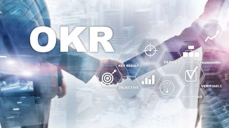 OKR - objective key result concept. Mixed media on a virtual structured screen. Project management. Фото со стока