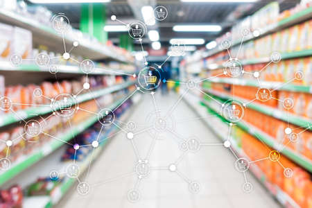 Shopping cart structure Retail marketing E-commerce blurred supermarket background. Stock Photo