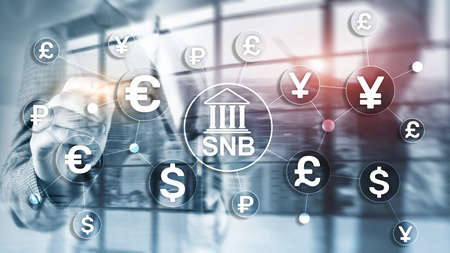 Different currencies on a virtual screen. SNB. Swiss National Bank