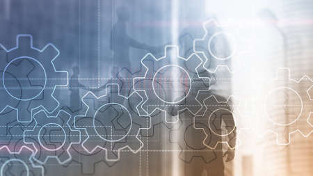 Double exposure gears mechanism on blurred background. Business and industrial process automation concept. Banco de Imagens