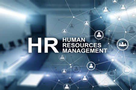 New Business Concept: Human Resources Managemen. Inscription on the background on blurry office.