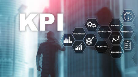 KPI - Key Performance Indicator. Business and technology concept. Multiple exposure, mixed media. Financial concept on blurred background. Stock Photo