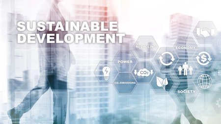 Sustainable development, ecology and environment protection concept. Renewable energy and natural resources. Double exposure of success businessman with abstract building
