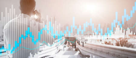 Stock trading candlestick chart and diagrams on blurred office center background.