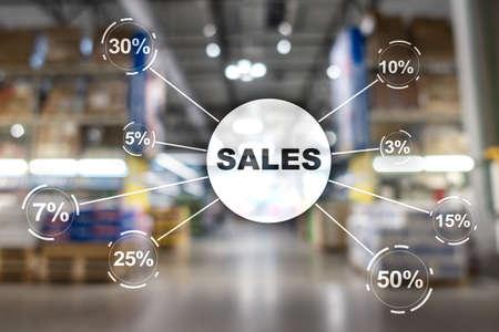 Sale discount concept. Inscription Sales on blurred shop background