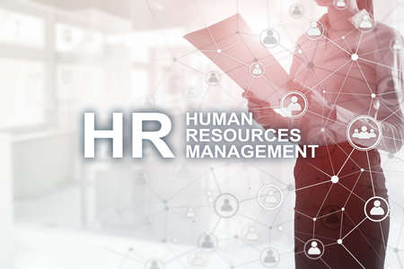 New Business Concept: Human Resources Management. Inscription on the background on blurry office.