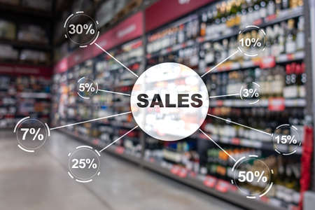 Sale discount concept. Inscription Sales on blurred shop background.