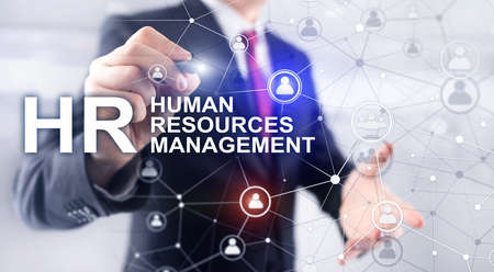 Businessman pointing on HRM Human Resource Management on virtual screen