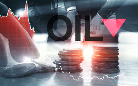 Price oil down. Oil barrels and a financial chart on abstract business background. Barrel arrow down. Oil trend down. Stockfoto