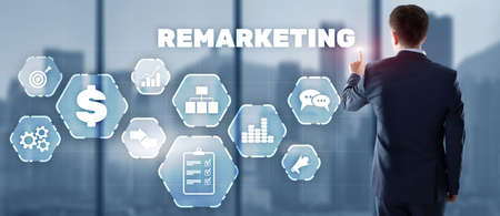 Remarketing digital marketing concept. Businessman presses remarketing on virtual screen. Standard-Bild - 155161436