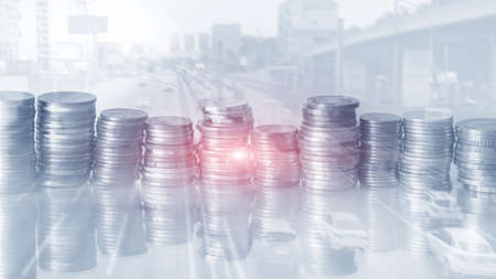 Double exposure rows of coins city background.