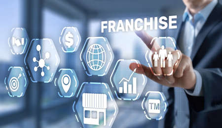 Business concept 2021 Franchise. Businessman is selecting Franchising.