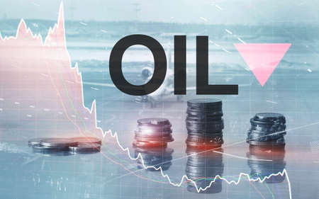 Price oil down. Oil barrels and a financial chart on abstract business background. Barrel arrow down. Oil trend down. Reklamní fotografie
