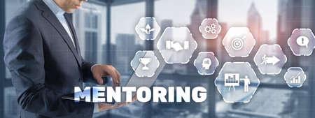 Businessman pressing inscription Mentoring. Training Personal development education coaching concept.