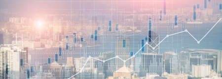 Financial concept investment graph chart diagram double exposure city view skyline.