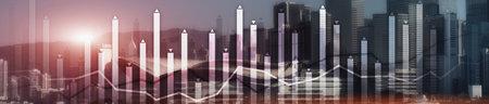 Modern Business Finance Chart Overlaid on Hong Kong Skyline at Night. Up and down arrow. Фото со стока