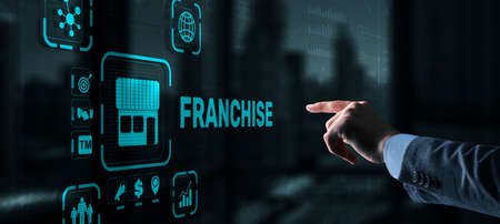 Businessman hand touching inscription Franchise marketing system