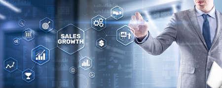 Sales Growth Man clicks inscription on virtual 3D screen