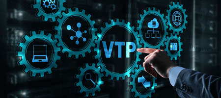 The man clicks on the inscription VTP. VLAN Trunking Protocol. Virtual Local Area Network