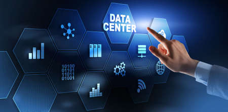 Finger presses on the icon Data Center. Business Concept