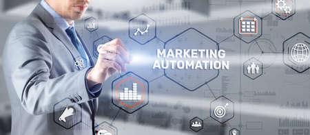 Marketing automation on the virtual screen. Man clicks on the inscription Marketing