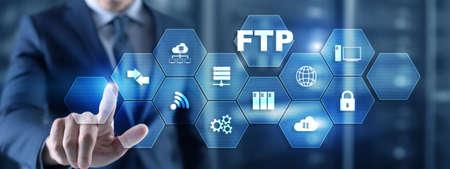 Businessman Hand touching FTP inscription. Mixed Media Technology concept