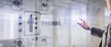 Trainning concept. Businessman pressing on touch screen interface inscription