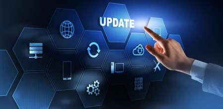 Businessman is pressing on the virtual screen Update Software Computer 版權商用圖片