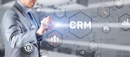 Customer relationship management system concept. Businessman touching finger CRM