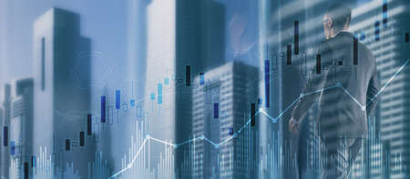 Trading candlestick chart and diagrams on blurred office center background people