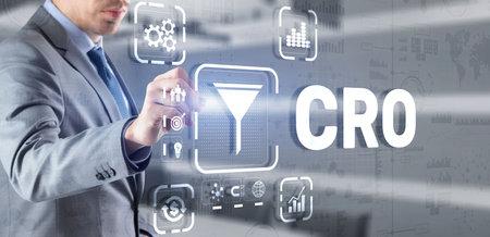 Conversion Rate Optimization. CRO Technology Finance concept Businessman pressing on a virtual screen 版權商用圖片