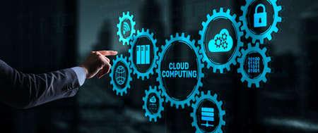 Cloud computing concept. Businessman is pressing on the virtual screen inscription Cloud computing 版權商用圖片