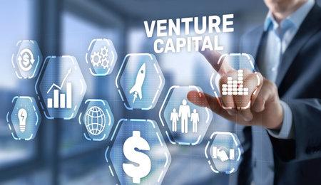 Businessman select VENTURE CAPITAL on virtual screen
