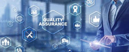 QA Businessman pressing Quality assurance button on virtual screens