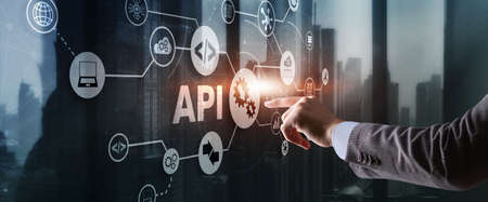 Application Programming Interface. API software development tool. Information technology concept. Businessman presses API text icon on a virtual interface