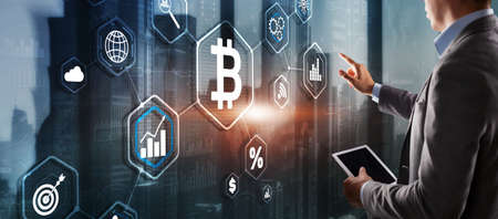 Hand touching Bitcoin button. Modern business technology concept. Bitcoin, Ethereum 版權商用圖片