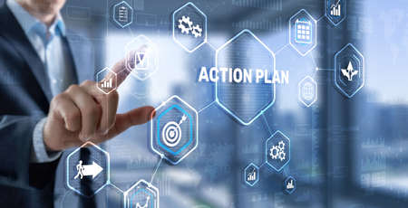 Businessman touching finger: Action Plan. Inscription on the virtual screen 版權商用圖片