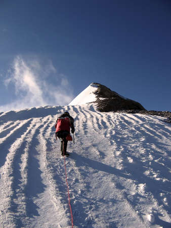 Caucasus. Sunny day after storm. Man on the top. Stock Photo