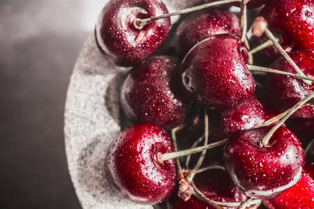 Red cherries in the stone bowl