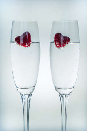 Valentines day background with champagne glasses and red hearts Stock Photo