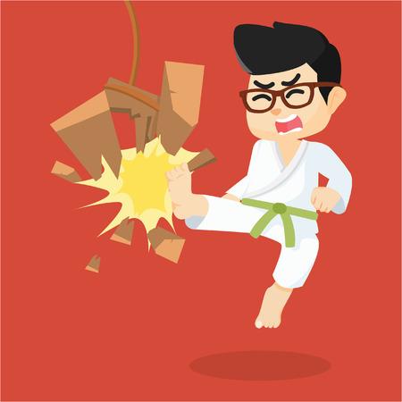 boy green belt karateka breaking board