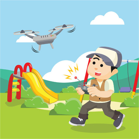 boy playing drone in park