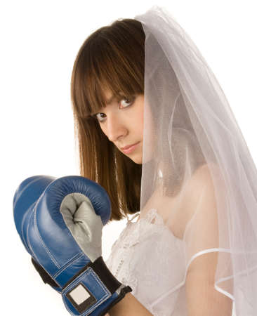 lifted hands: Young beautiful bride stands with lifted blue boxing gloves on her hands, isolated on  white background.
